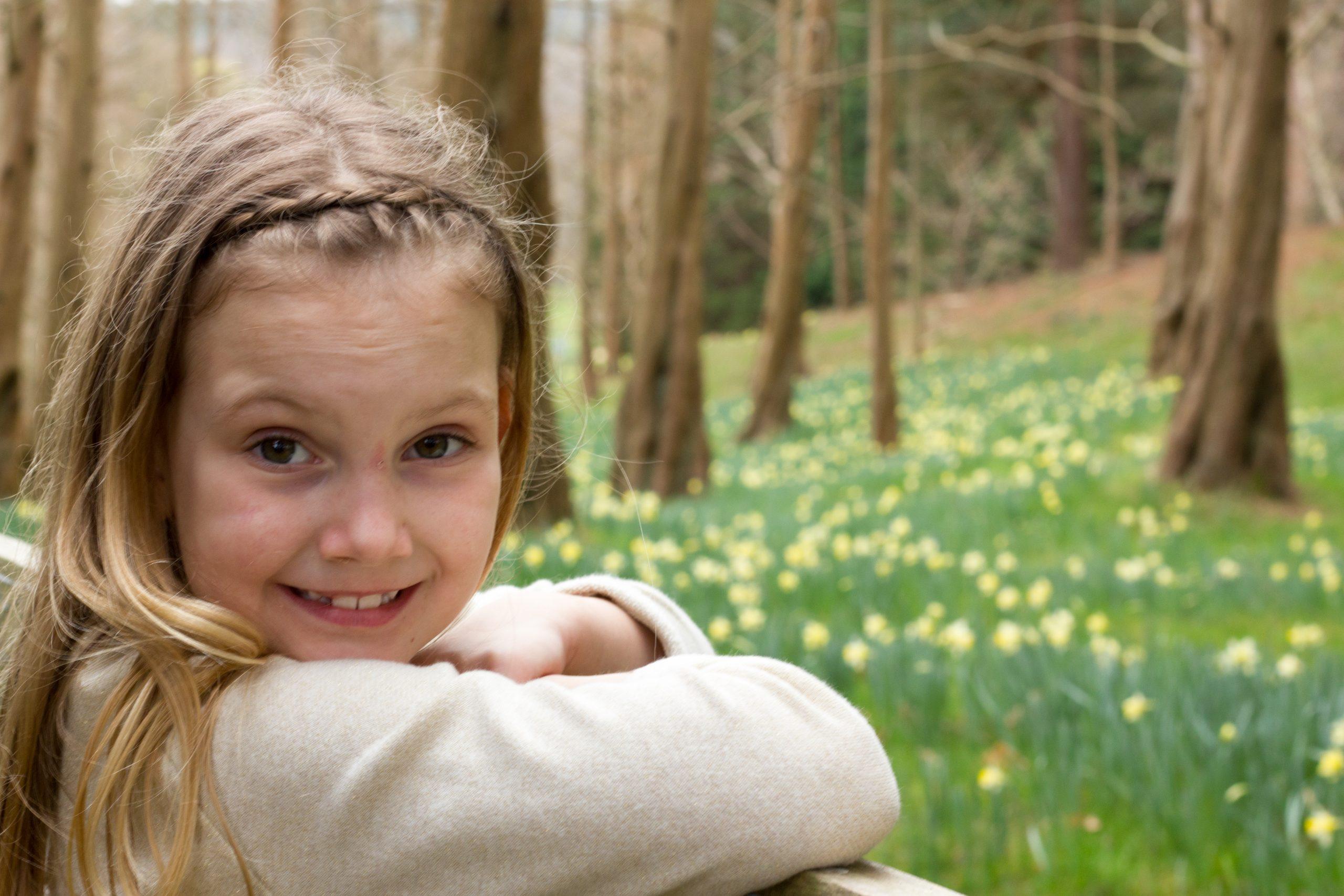 Girl looking at daffodils