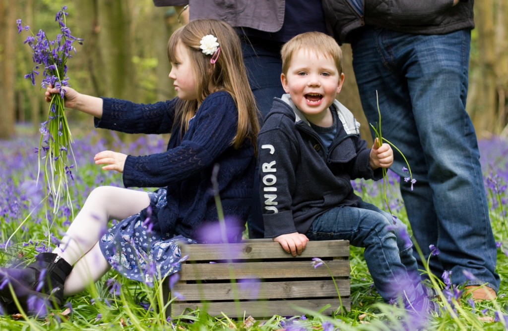 Happy boy in Spring bluebell woods